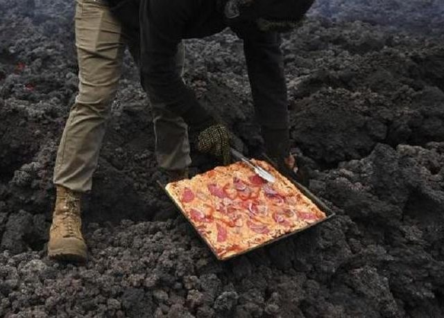 The Pizza Is Cooked Directly On The Heat Of The Volcano